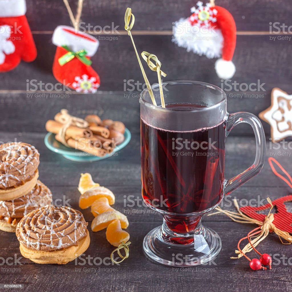Mulled wine, cookies, tangerines and cinnamon. Christmas background. stock photo