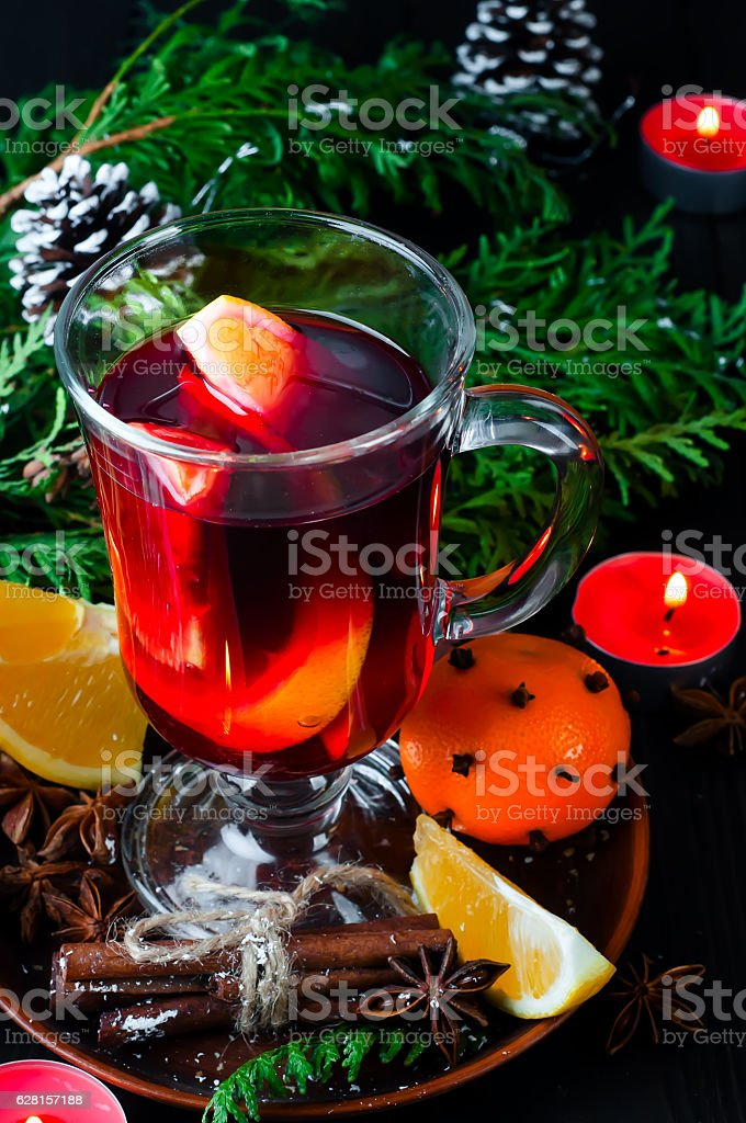 Mulled wine for Christmas Eve celebration party by  tree. stock photo