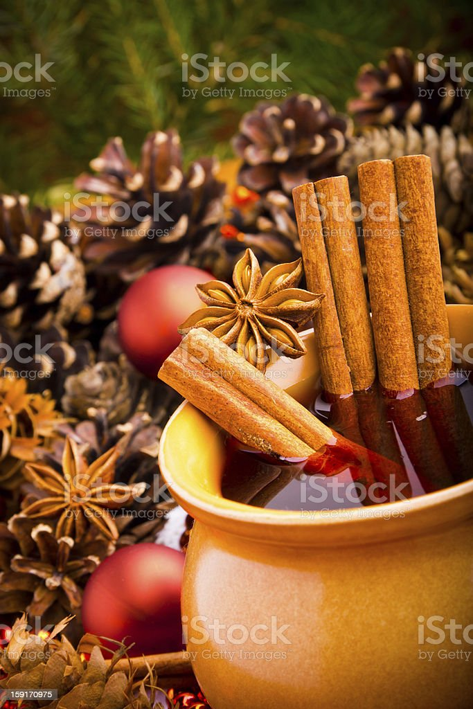 Mulled wine in brown jug with cinnamon and anise royalty-free stock photo