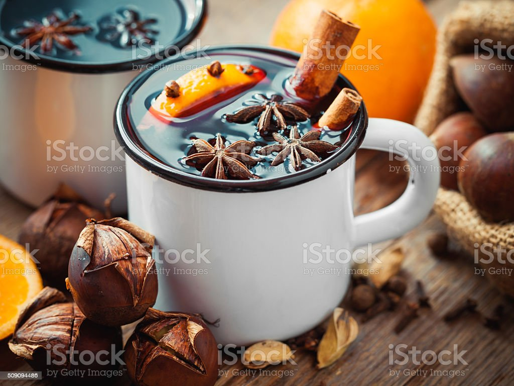 Mulled wine in mugs and roasted chestnuts stock photo