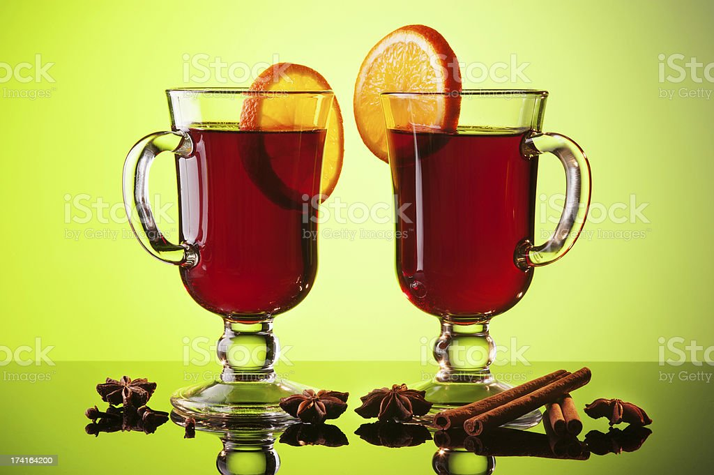 Mulled wine in two glasses on green royalty-free stock photo