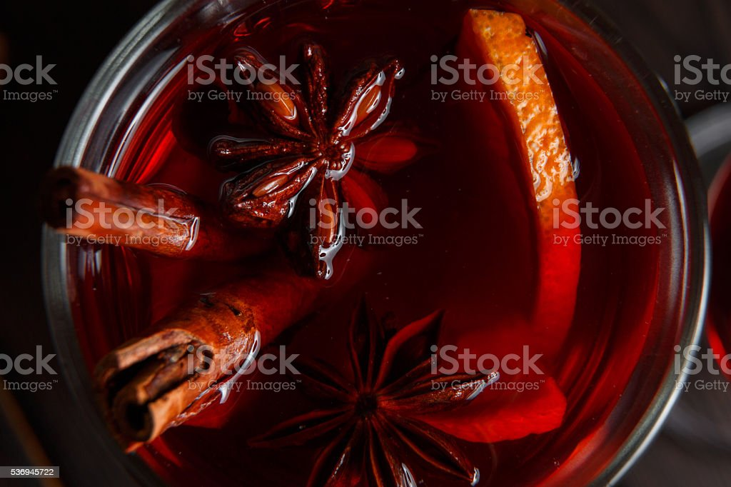 Mulled wine on the dark old wood background stock photo