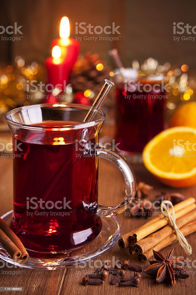Mulled wine or glühwein on a rustic table stock photo