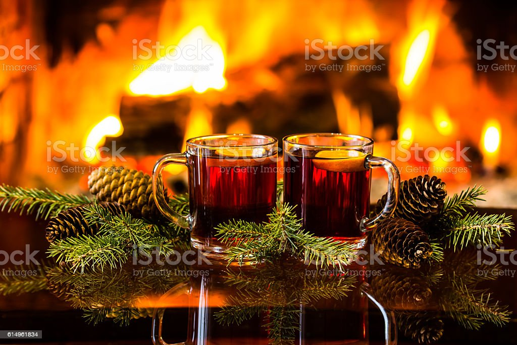 Mulled wine or hot drink, christmas decoration, fireplace stock photo