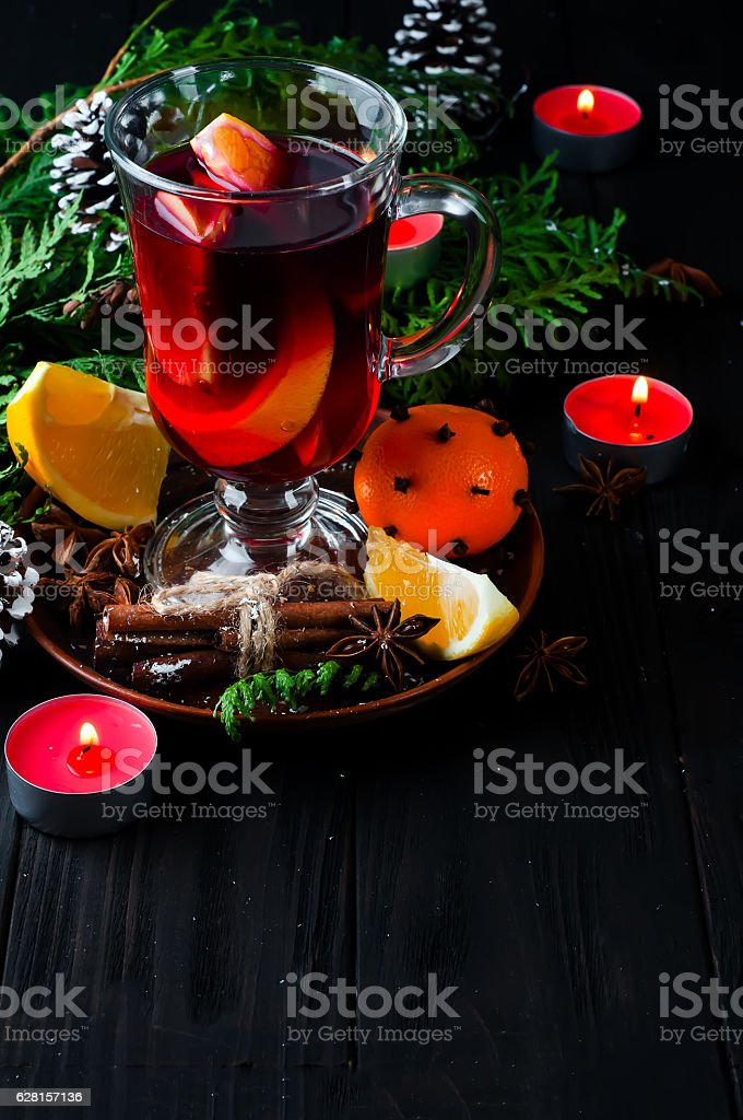 Mulled wine, tree branch and spices stock photo