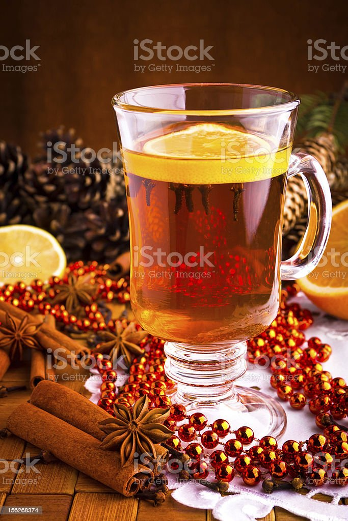 Mulled wine with cinnamon sticks and christmas anise stars royalty-free stock photo