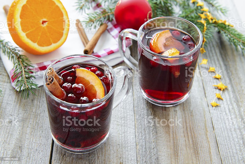 Mulled wine with cranberries and orange royalty-free stock photo