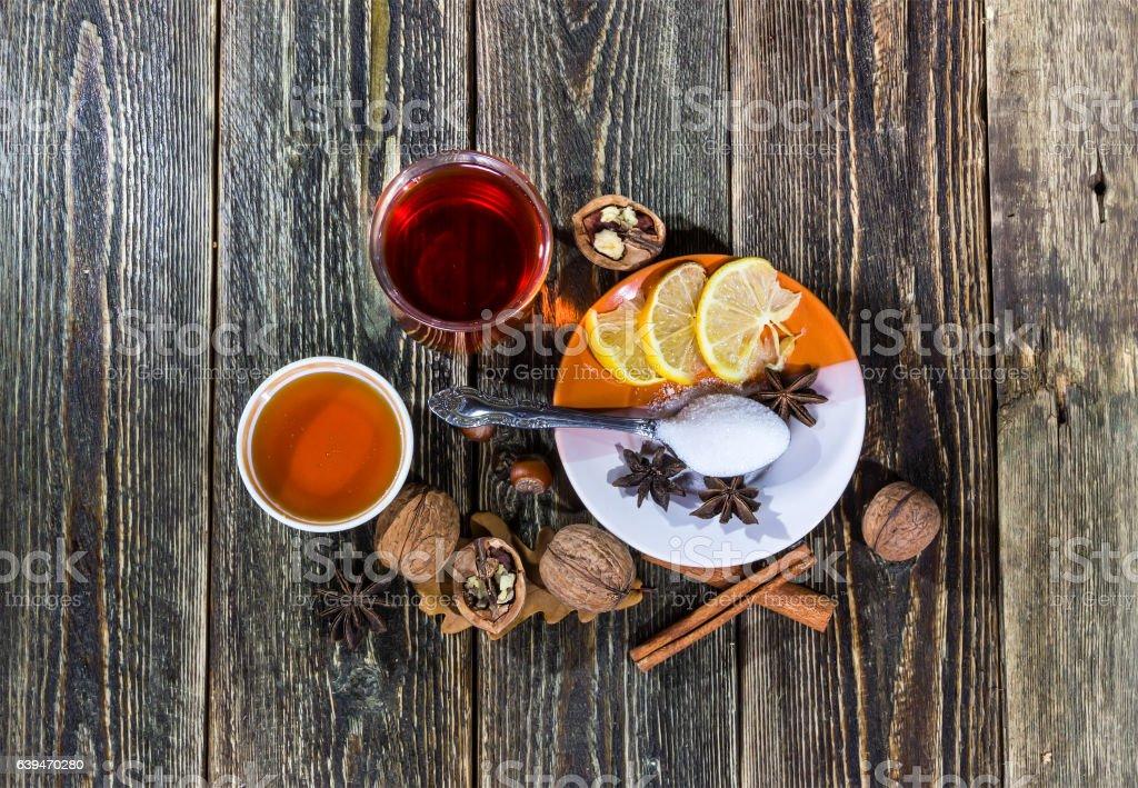Mulled wine with honey, cinnamon and lemon stock photo