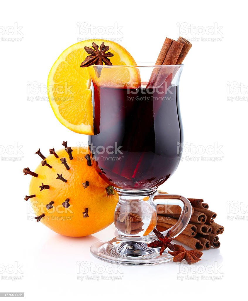 Mulled wine with spices isolated on white royalty-free stock photo