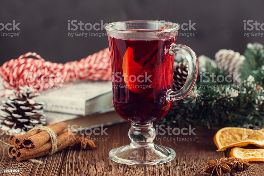 Mulled wine with spices on dark background stock photo