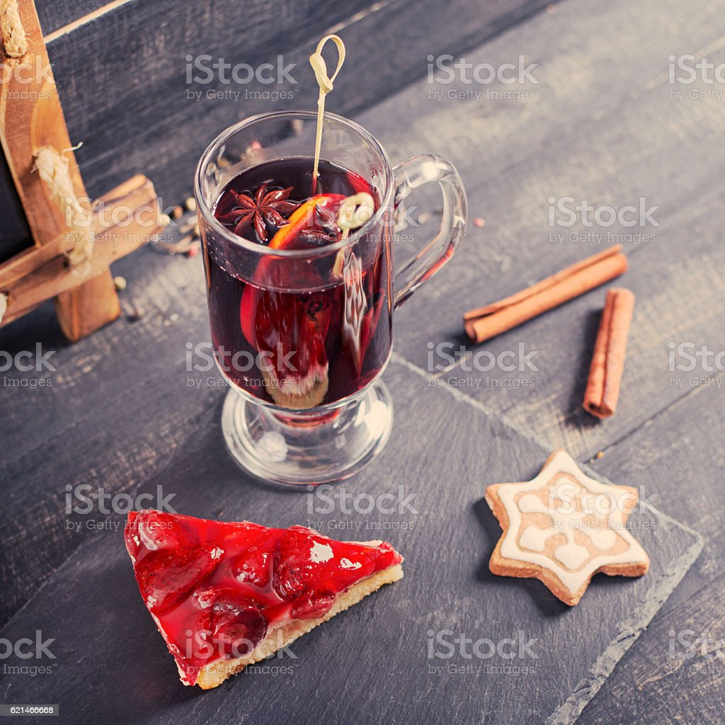 Mulled wine with strawberry pie and Christmas cookies. Vintage design. stock photo