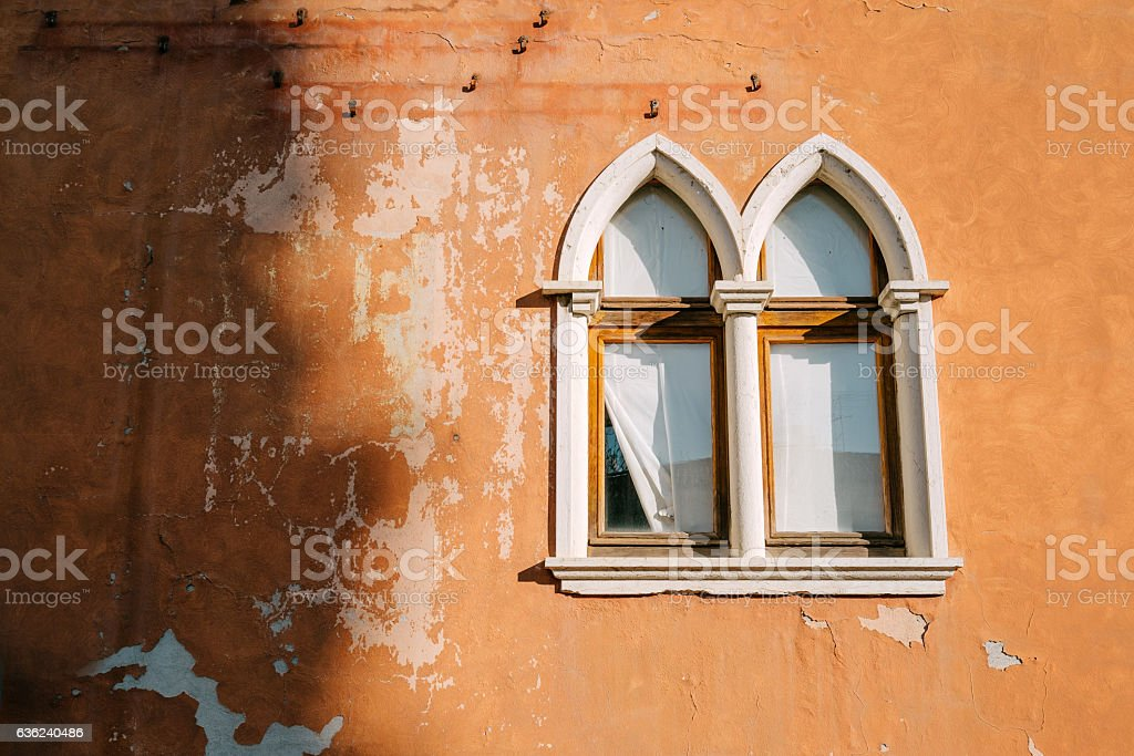 Mullioned windows of the old house stock photo