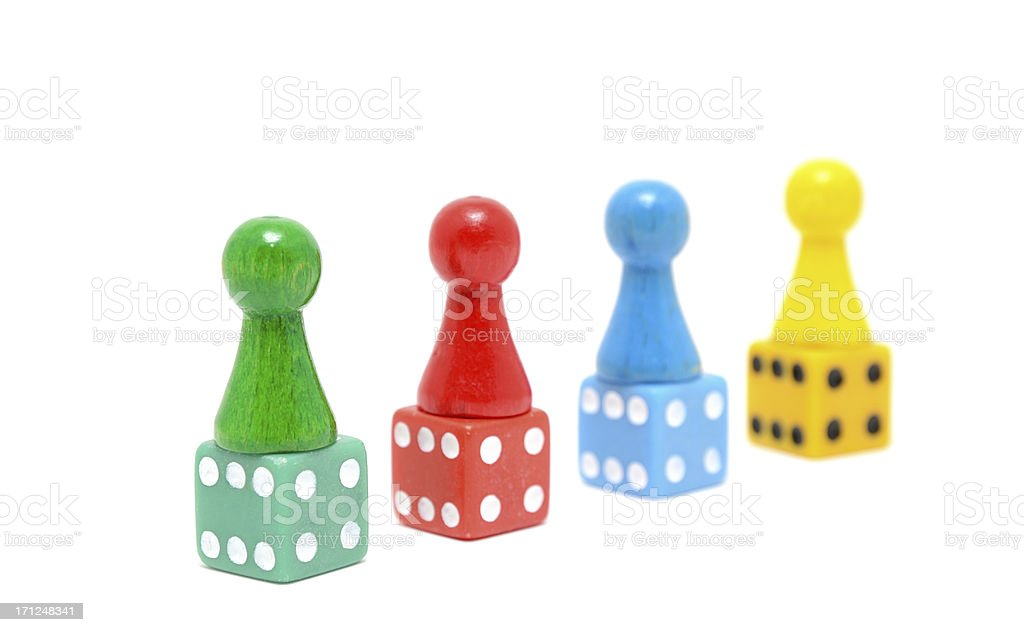 Multi Color Board Game Pieces on dice with white background royalty-free stock photo