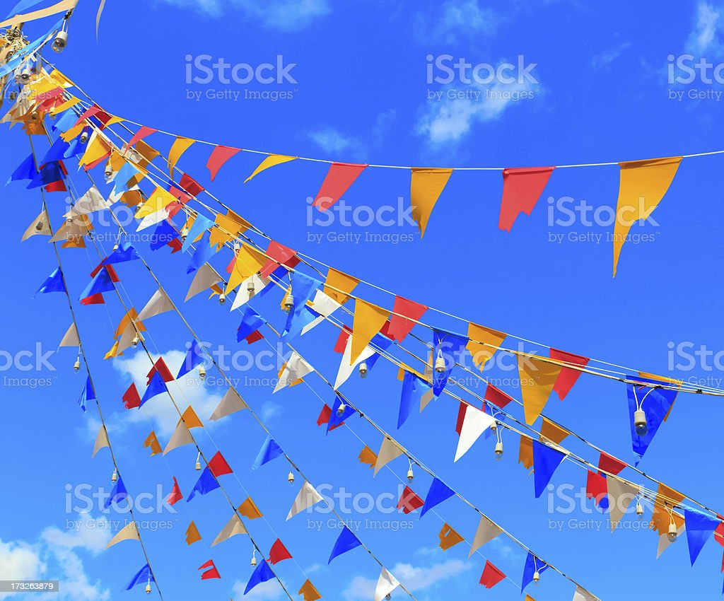 Multi color bunting flags reaching up to the sky royalty-free stock photo