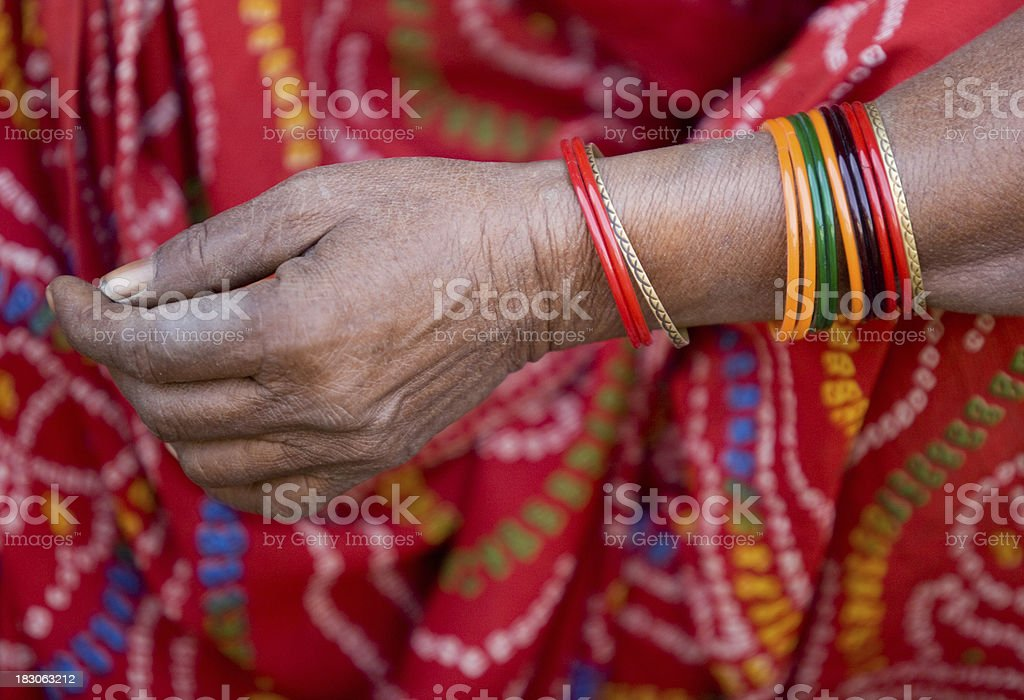 Multi colored bracelets on hands of indian woman royalty-free stock photo