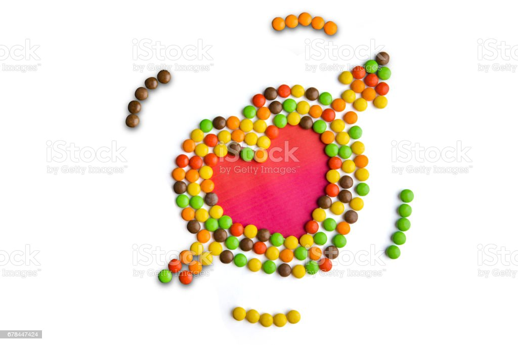 Multi colored candies shaped heart symbol stock photo