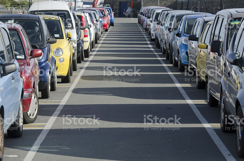 Multi colored cars in a row royalty-free stock photo