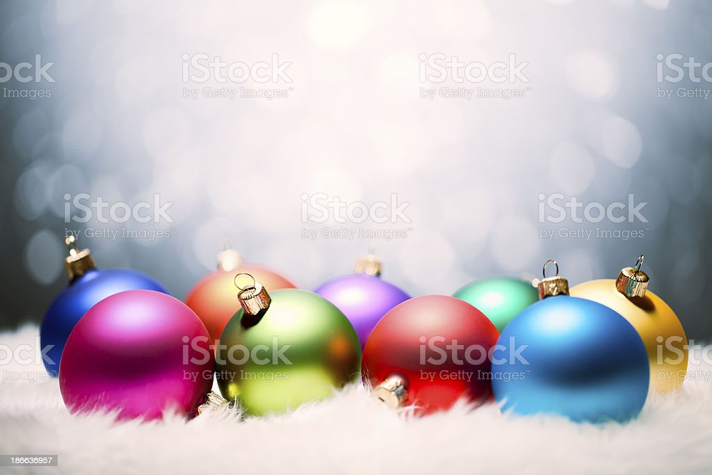Multi colored christmas ornaments - Decoration Snow Background Winter Holiday royalty-free stock photo