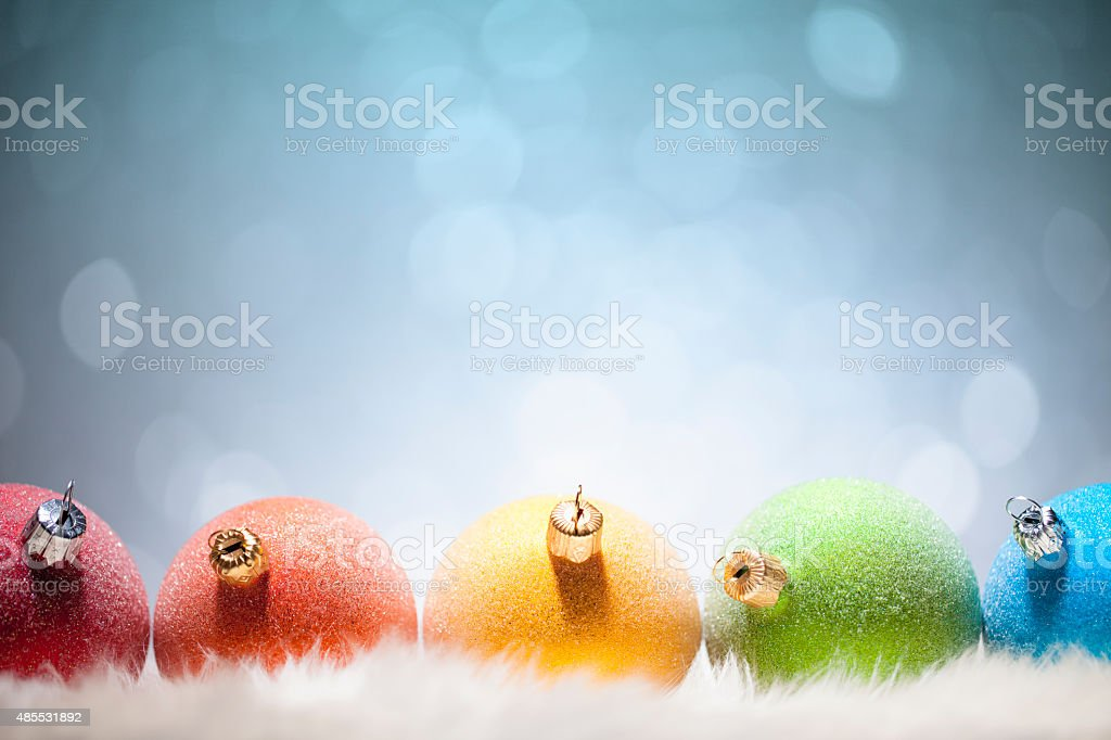 Multi colored christmas ornaments - Decoration Snow Background Winter Holiday stock photo