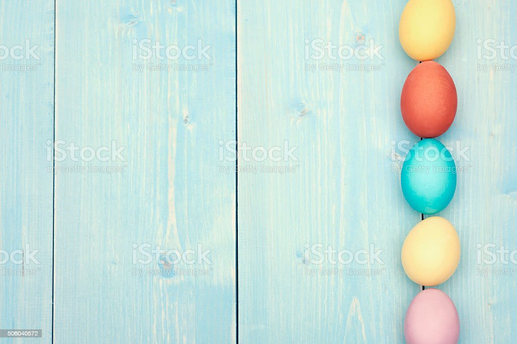 Multi colored easter eggs in a row stock photo