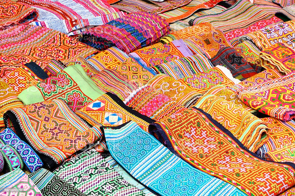 Multi colored fabrics of vietnamese minorities stock photo