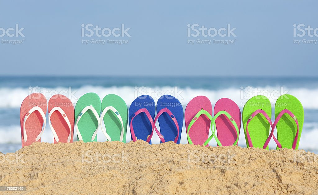 Multi colored flip flop in a row. royalty-free stock photo