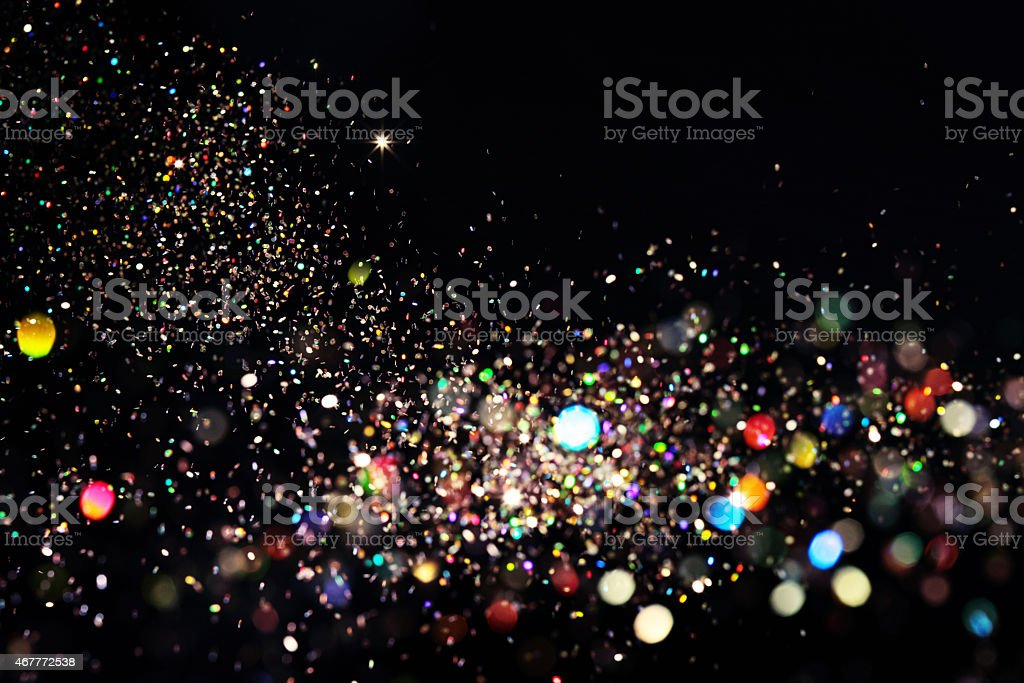 Multi colored glitter falling stock photo