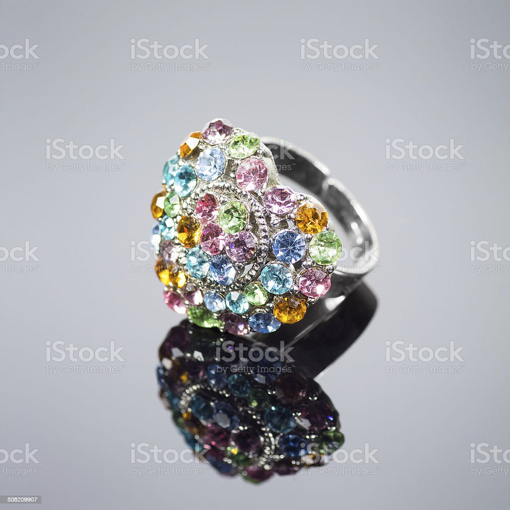 Multi colored heart shaped diamond ring stock photo