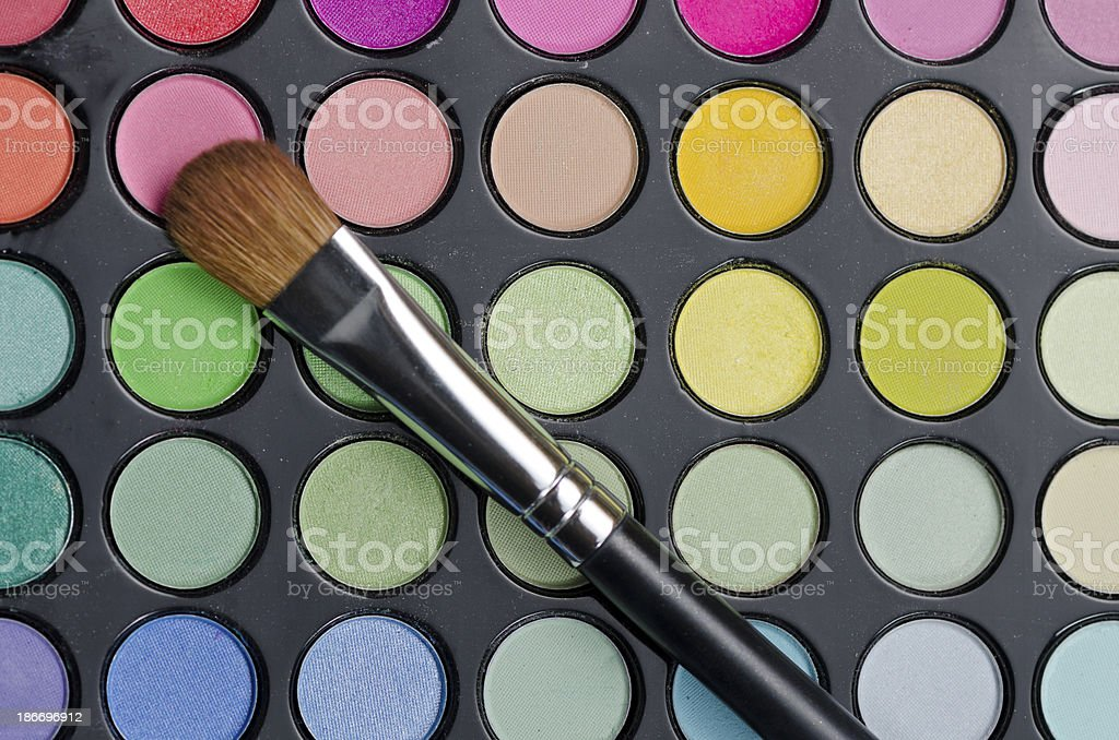 Multi colored make-up and brush royalty-free stock photo