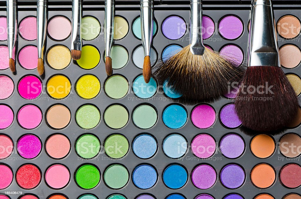 Multi colored make-up and brushes stock photo
