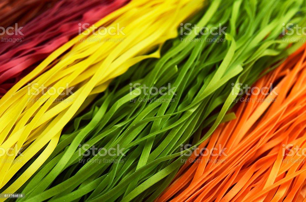 multi colored pasta diagonally horizontal format stock photo