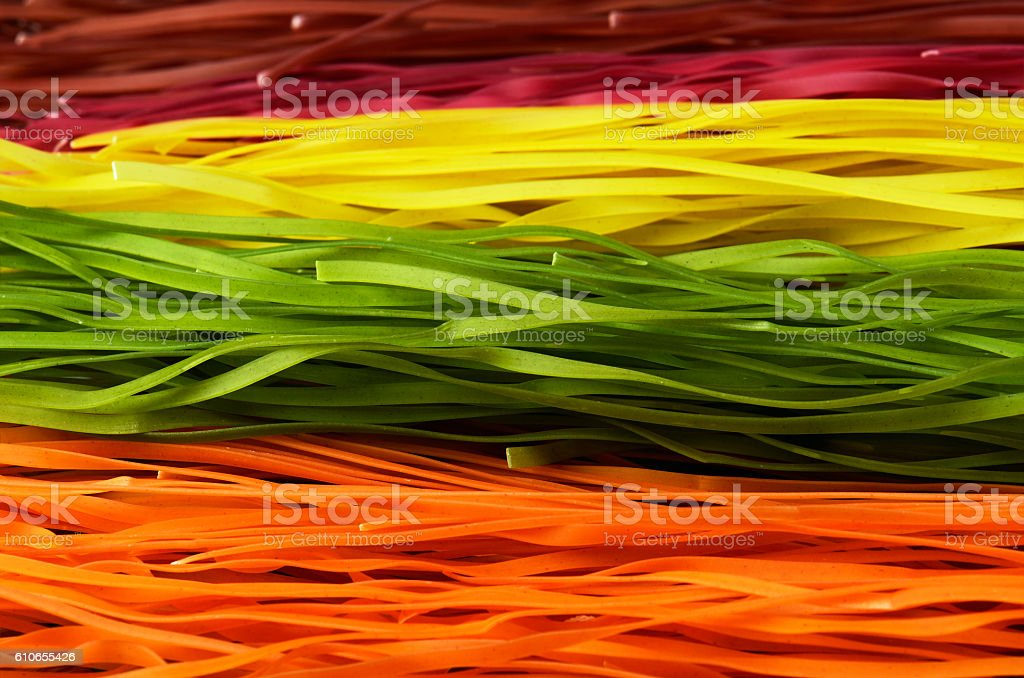 multi colored pasta on a full frame horizontal stock photo