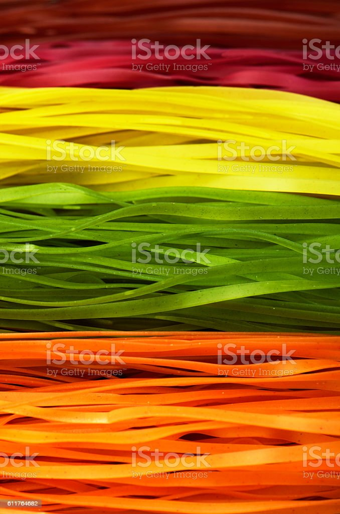 multi colored pasta on a full frame. vertical stock photo