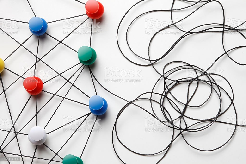 Multi Colored Pish Pins Connected By Black Thread stock photo