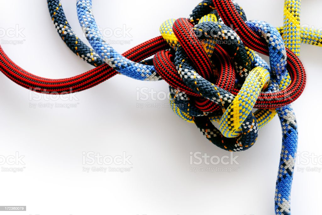 Multi colored rope in a Gordian knot stock photo
