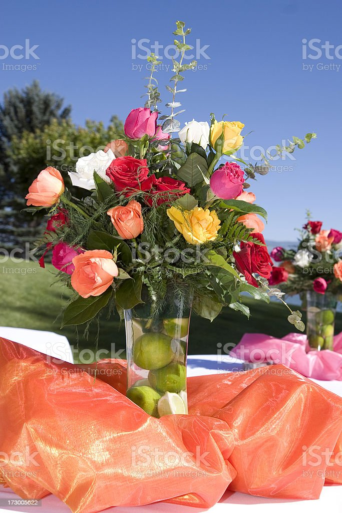 Multi Colored Rose Flower Bouquet in Vase as Table Decoration royalty-free stock photo