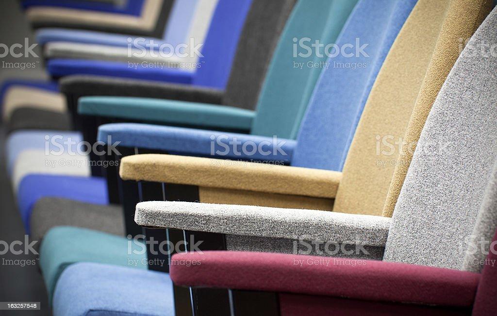 Multi colored seats in an auditorium.