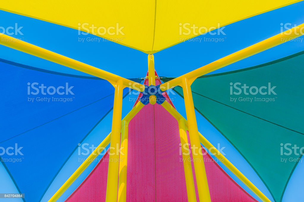 Multi colored sun shades against blue sky, close up (P) stock photo