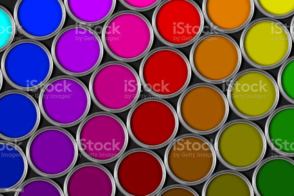 Multi colored tins of paint on black bacground royalty-free stock photo