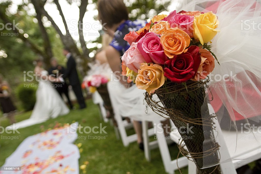 Multi colored Wedding Bouquet at ceremony with couple royalty-free stock photo
