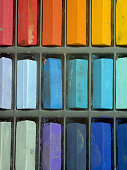 Multi coloured artists pastel crayons full frame close up