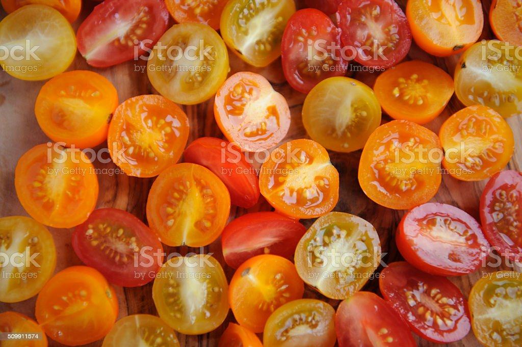 Multi Coloured Cherry Tomatoes cut in half stock photo