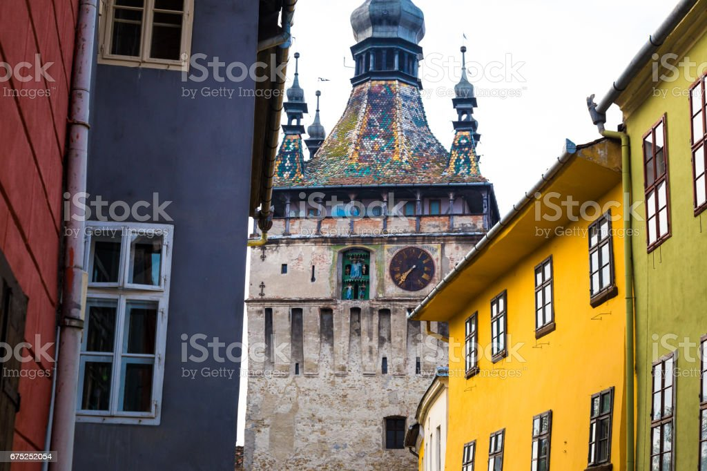 Multi coloured houses and clock tower in Sighisoara old town, Transylvania, Romania stock photo