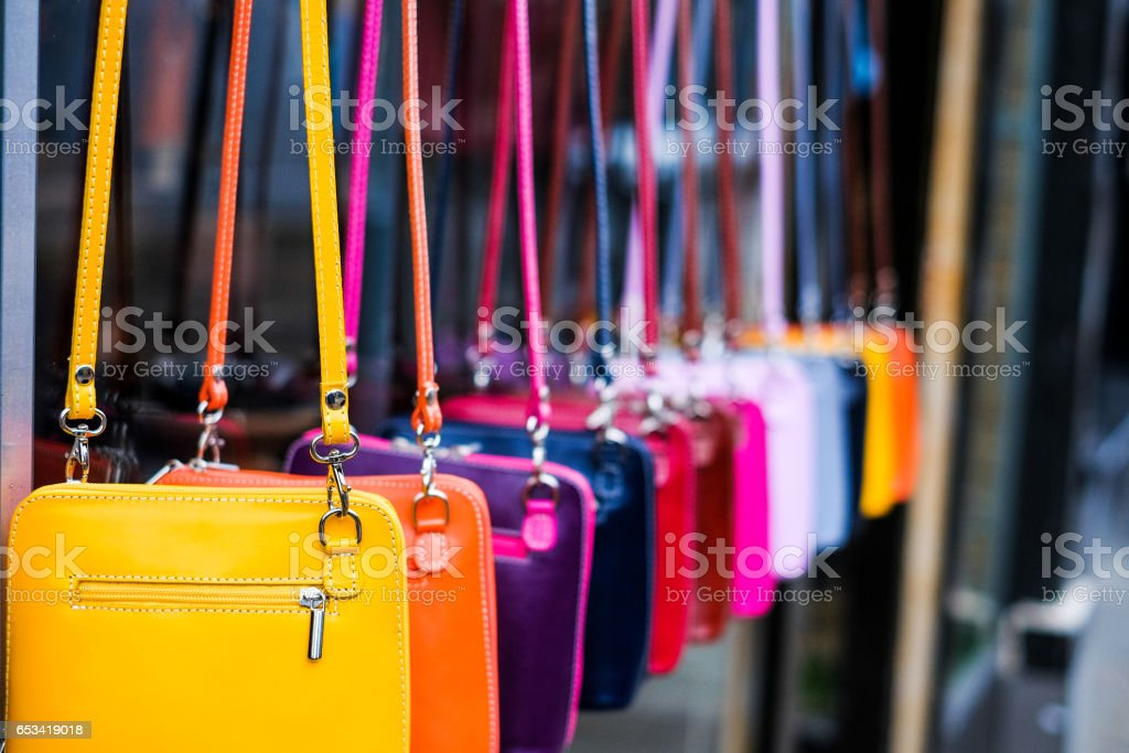 Multi coloured leather womens handbags in a row stock photo