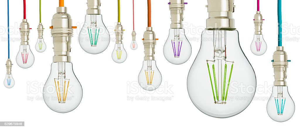 Multi coloured light bulbs hanging from coloured cord stock photo