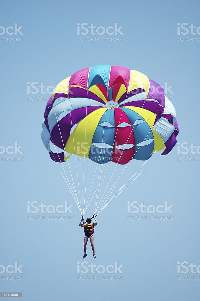 Multi coloured parachute over the blue sky stock photo