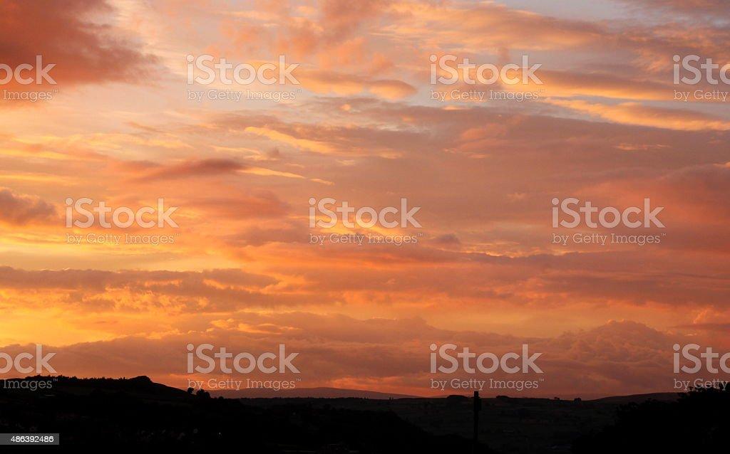 Multi Coloured sky at Sun set Horizon silhouette stock photo