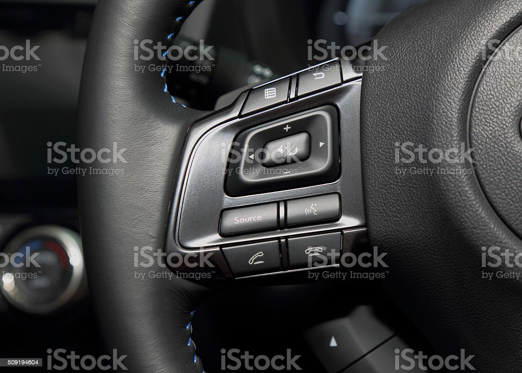 Multi control buttons on steering wheel of the luxury car stock photo