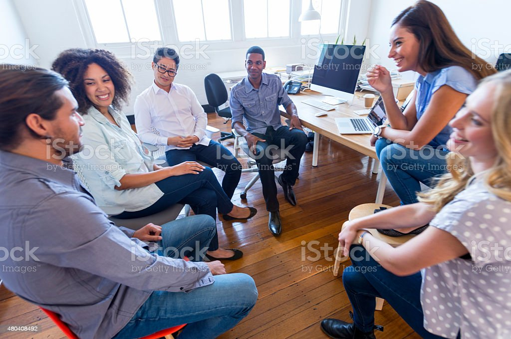 Multi cultural group of business people in a meeting. stock photo