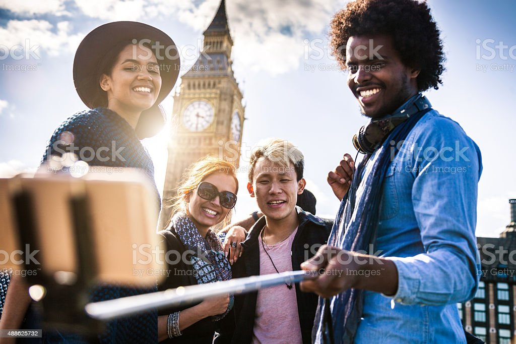 Multi cultural group of friends taking a selfie with BigBen stock photo